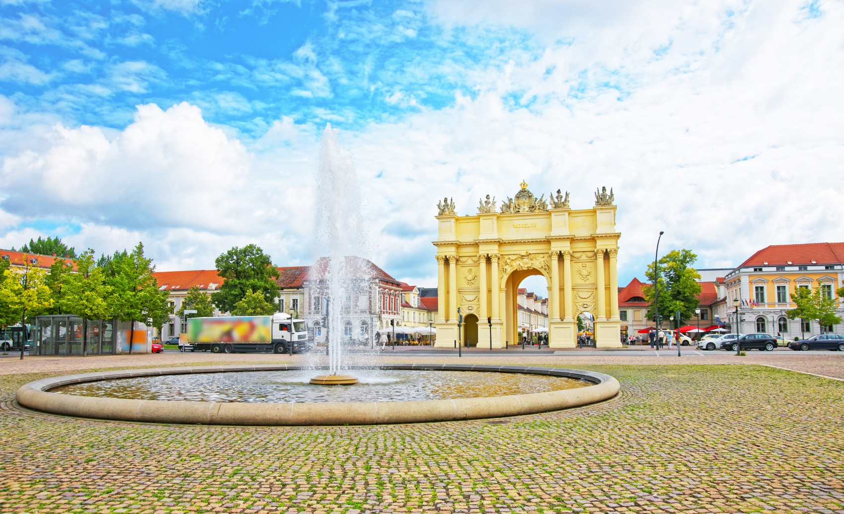 Street view on Brandenburg Gate and fountain in Potsdam