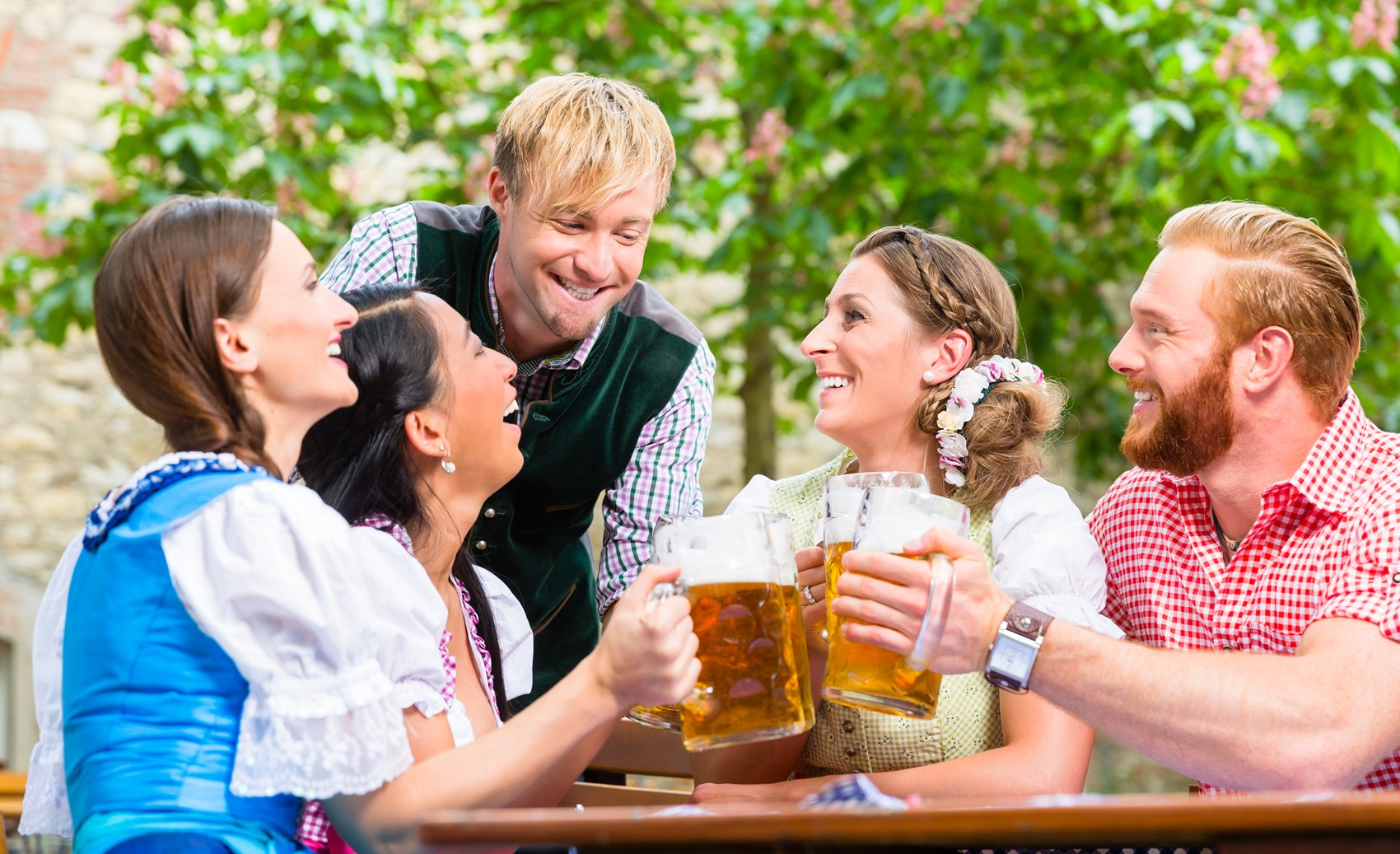Friends clinking glasses in beer garden
