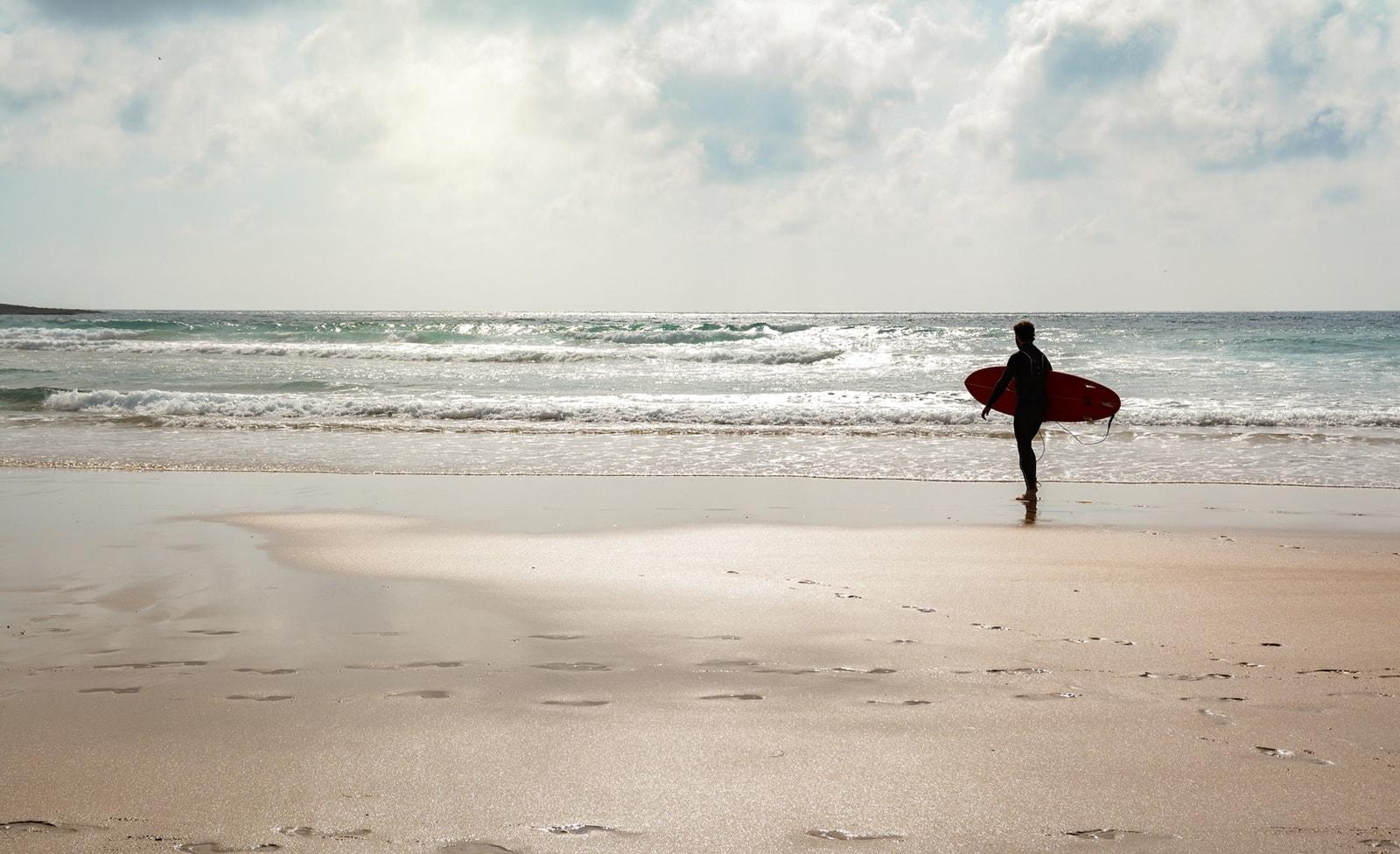 Surfer am Strand von Amado
